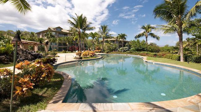 The pool is surrounded in privacy and tranquility with tropical landscaping