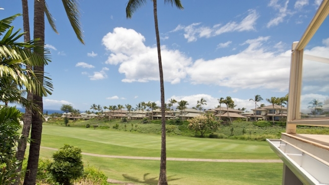 Sweeping views of the golf course from your private lanai of Grand Champions
