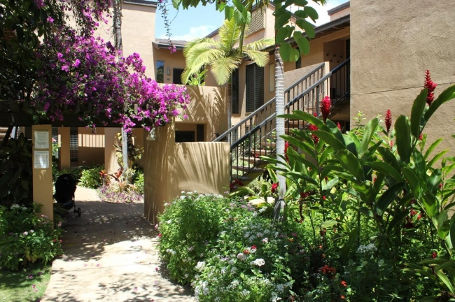 Convenient access to the second story units with well-appointed landscaped pathways