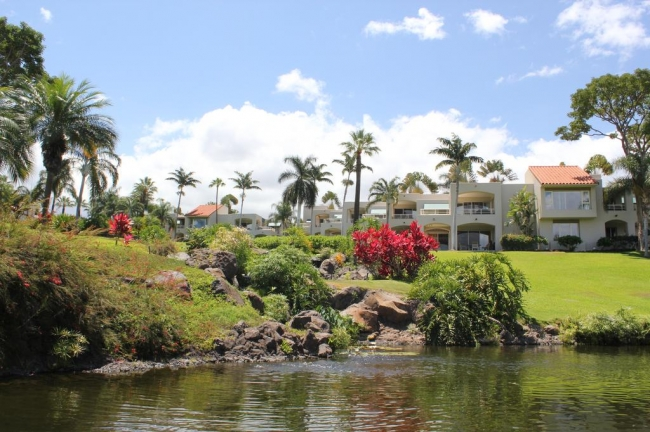 A creek runs down through the center of the Palms at Wailea property to a lagoon area