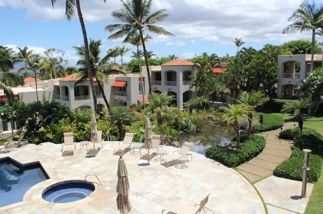 Tropical gardens and water features welcome residents at Wailea Palms
