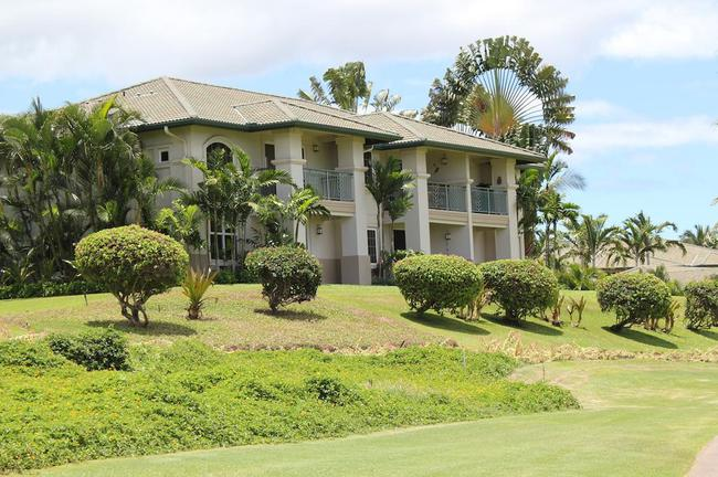 Manicured shrubs and trees are present in the Wailea Fairway Villas community