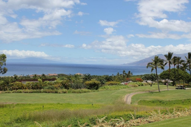 Golf cart paths, fairways, the Pacific Ocean and neighboring islands grace the landscape from Wailea Fairway Villas